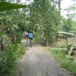 view of path and wife on her bike