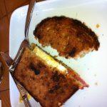 A partially eaten egg sandwich