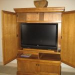 flat panel TV in a cabinet